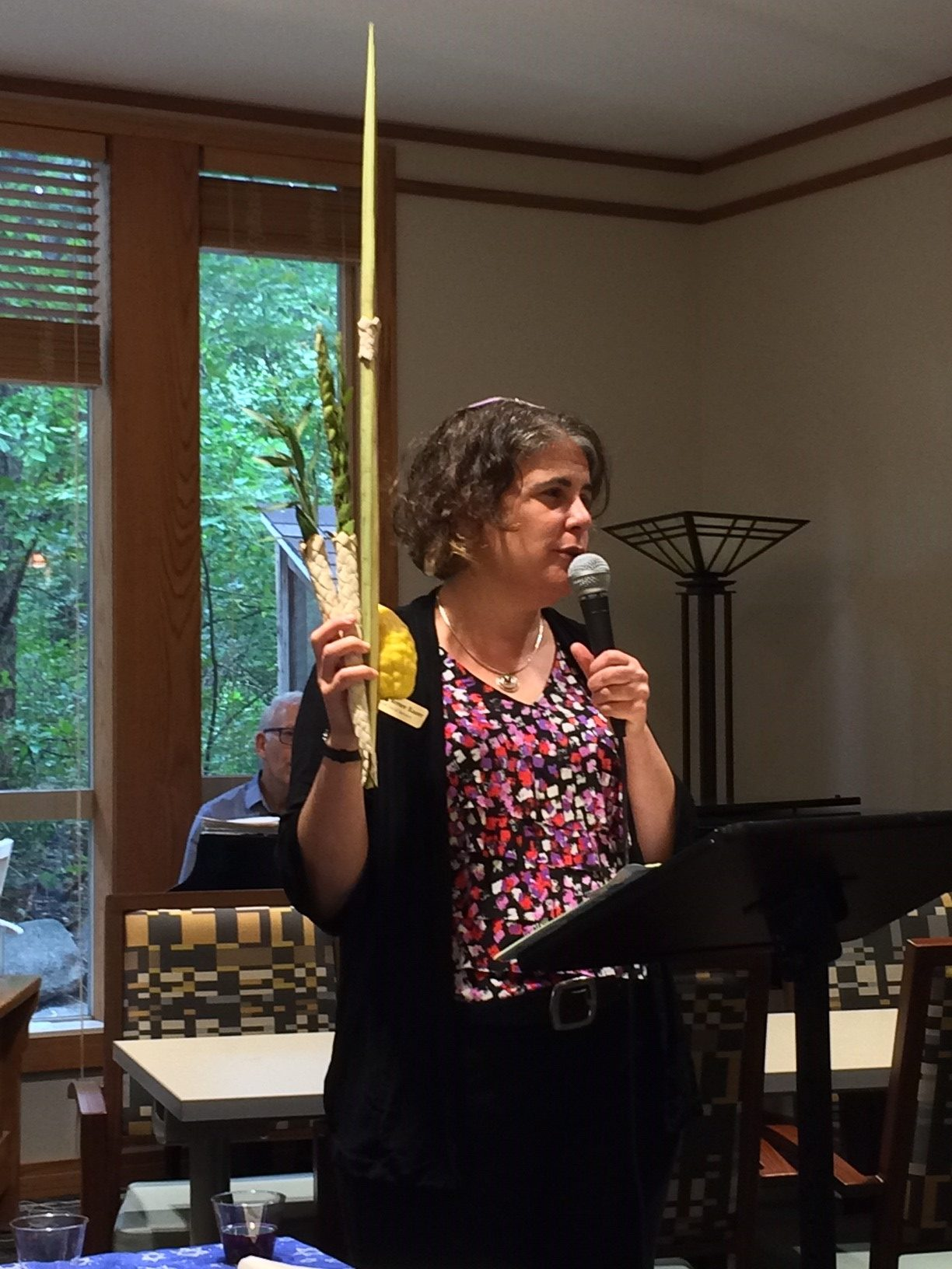 Rabbi Renee holds lulav and etrog