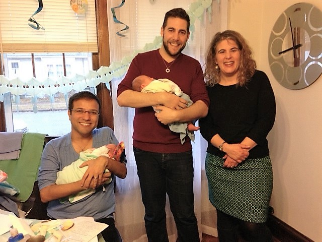 Rabbi Renee Bauer and two new fathers