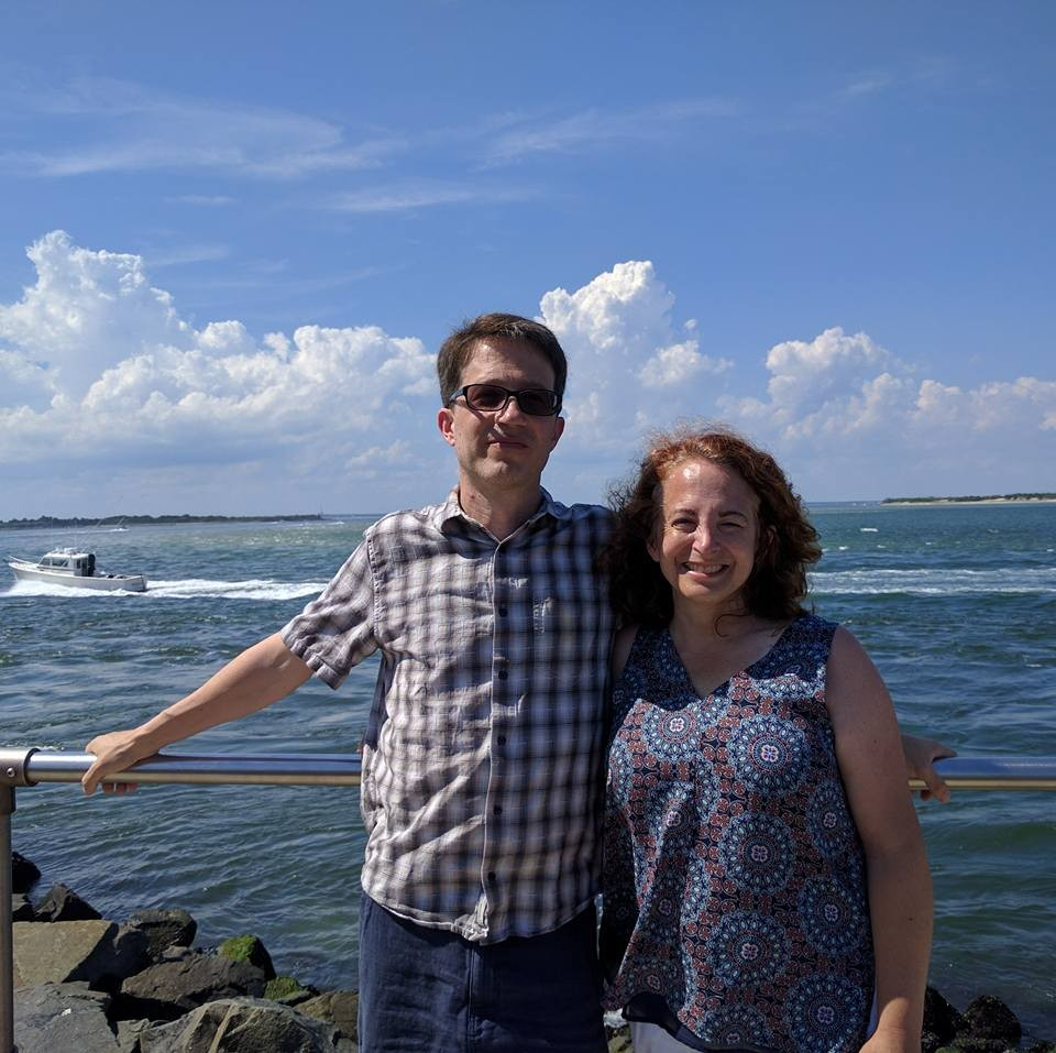 Image of Dawn and husband Ed standing in front of water