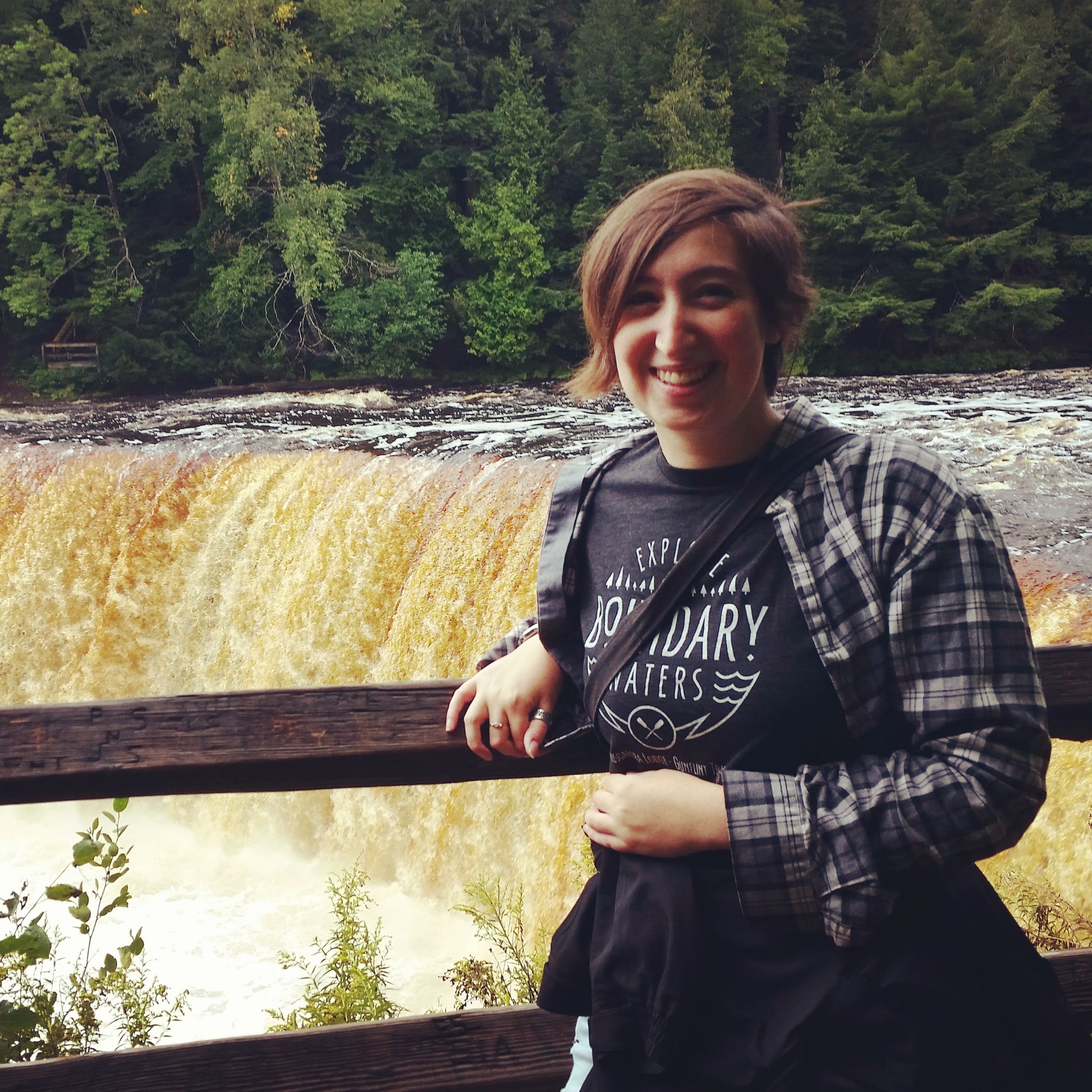 Image of Marian standing in front of waterfall